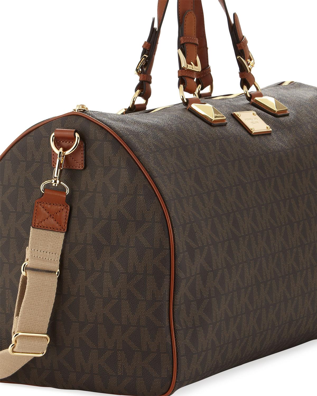 606832de5282 Lyst - MICHAEL Michael Kors Large Jet Set Logo Pvc Duffle Bag in Brown
