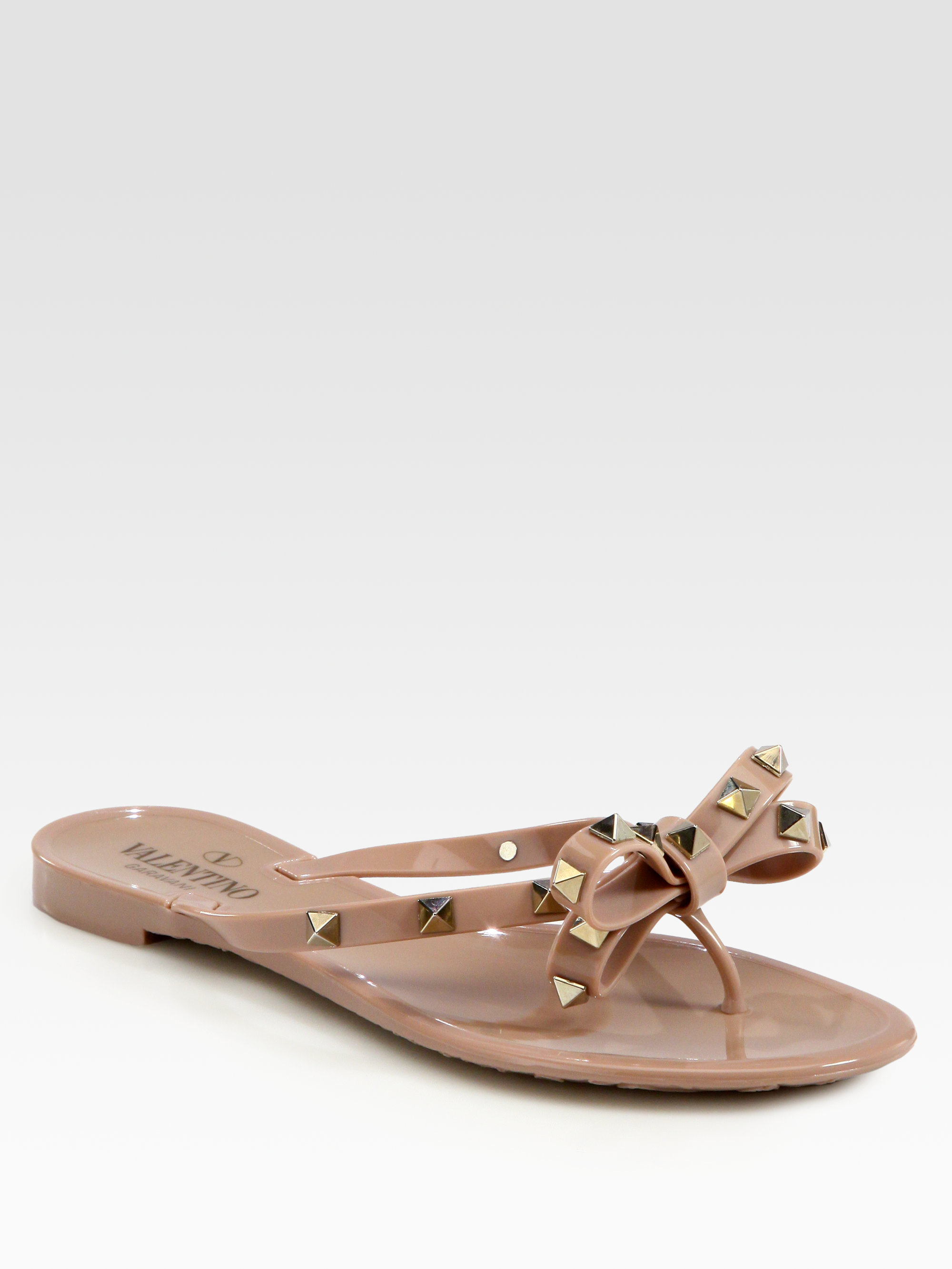 be1d22eb980e Lyst - Valentino Rockstud Studded Thong Bow Jelly Flip Flops in Black