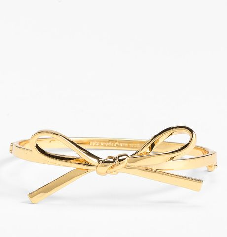 Kate Spade Skinny Mini Bow Bangle in Gold - Lyst