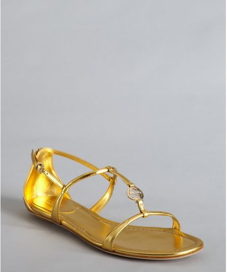 Gucci Gold Metallic Leather Logo Charm Strappy Sandals In