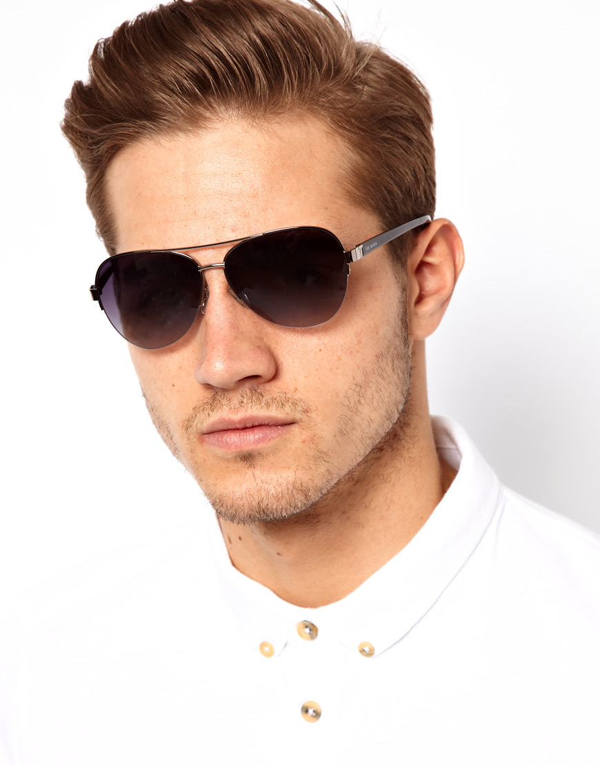 These aviator style polarized sunglasses for Silver Mirrored Aviator Sunglasses Shades – 70's Style Adult Aviators Costume Glasses - 1 Pair by Big Mo's Toys.