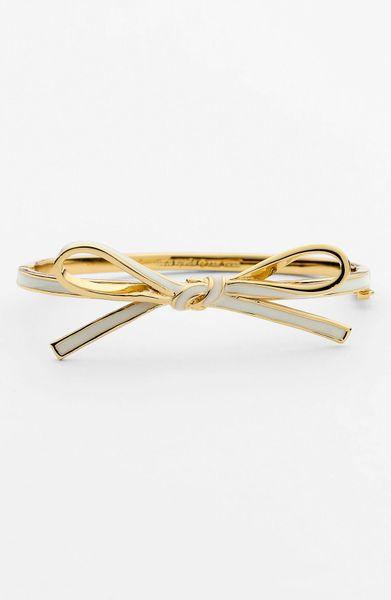 Kate spade skinny mini bow bangle in gold cream gold lyst
