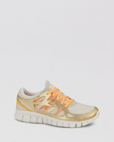 nike free run 2 prm ext gold trainers