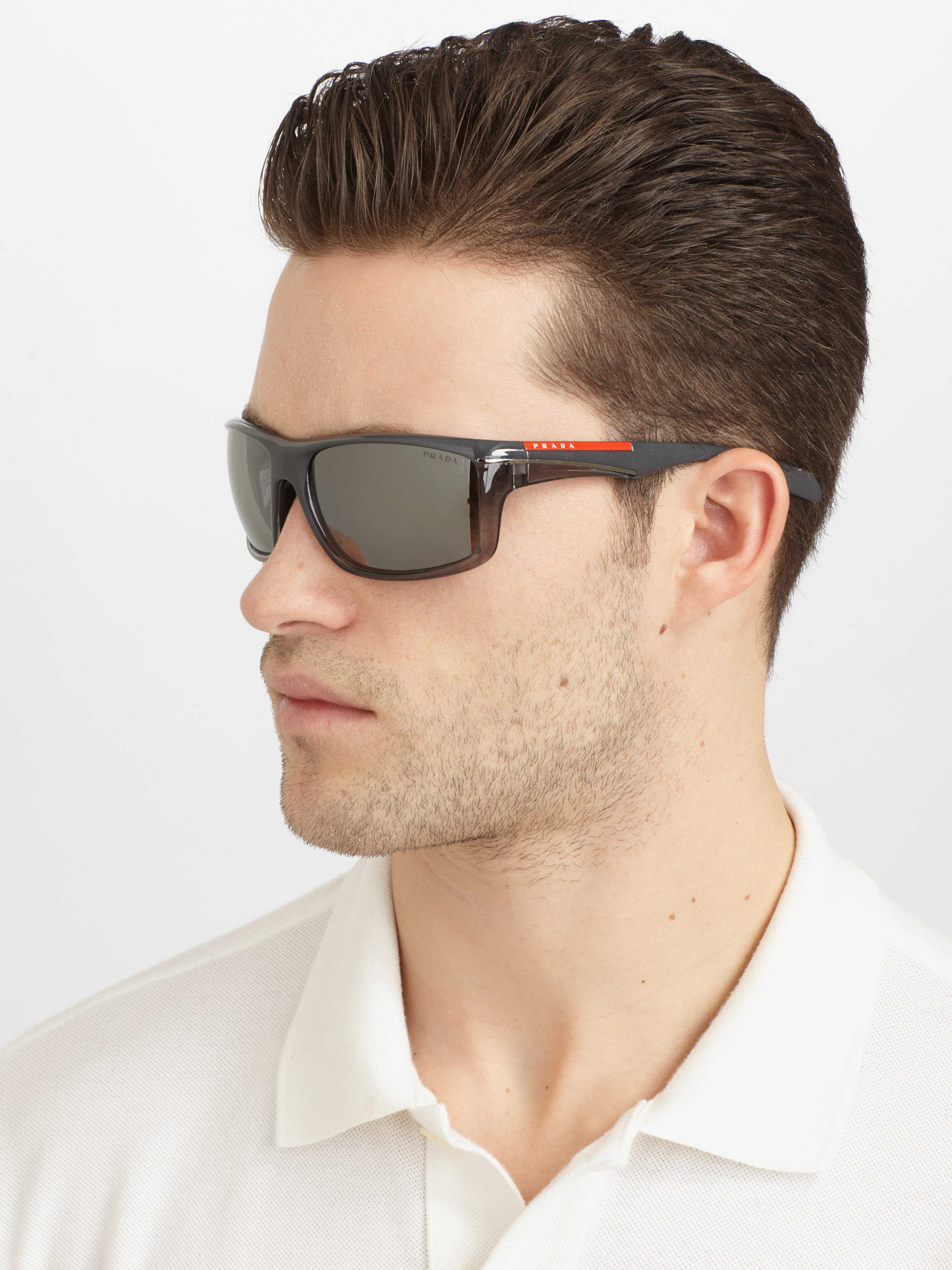 7b720586ebc6 ... shop prada sport wrap sunglasses in black for men lyst 21ab2 cd42b