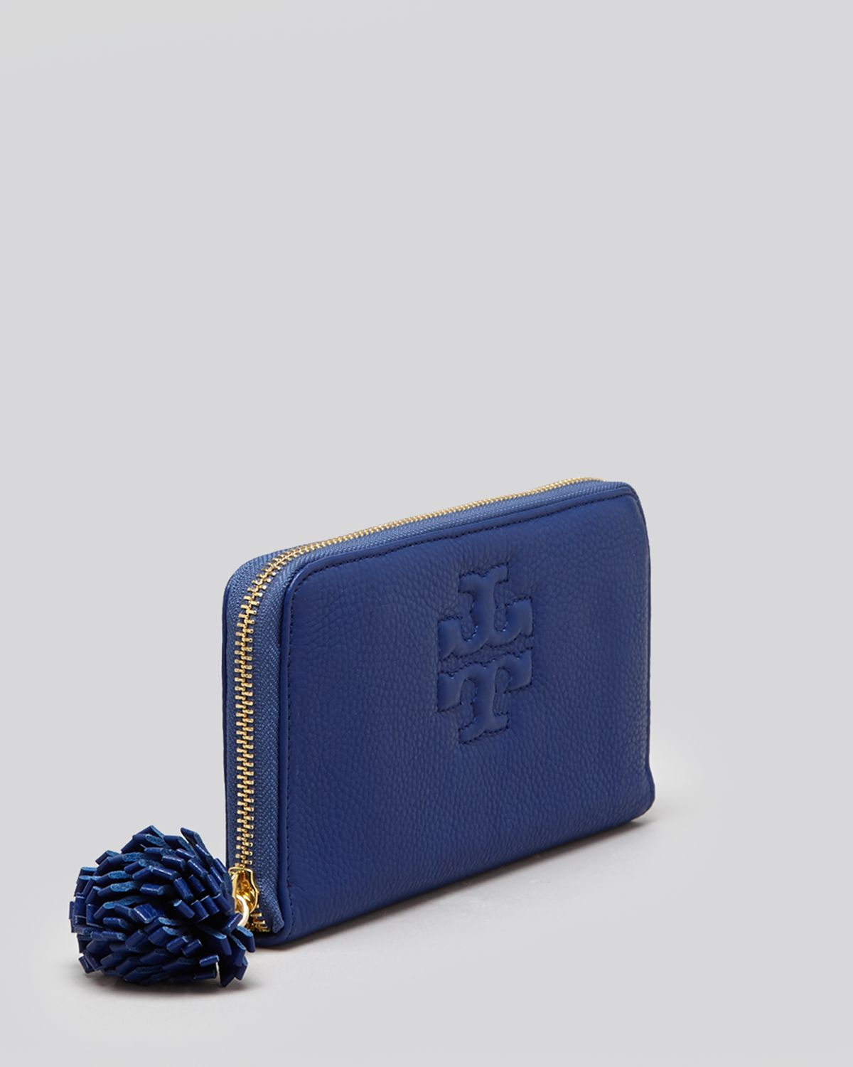 da377781e Lyst - Tory Burch Wallet Thea Zip Continental with Pom Pom in Pink