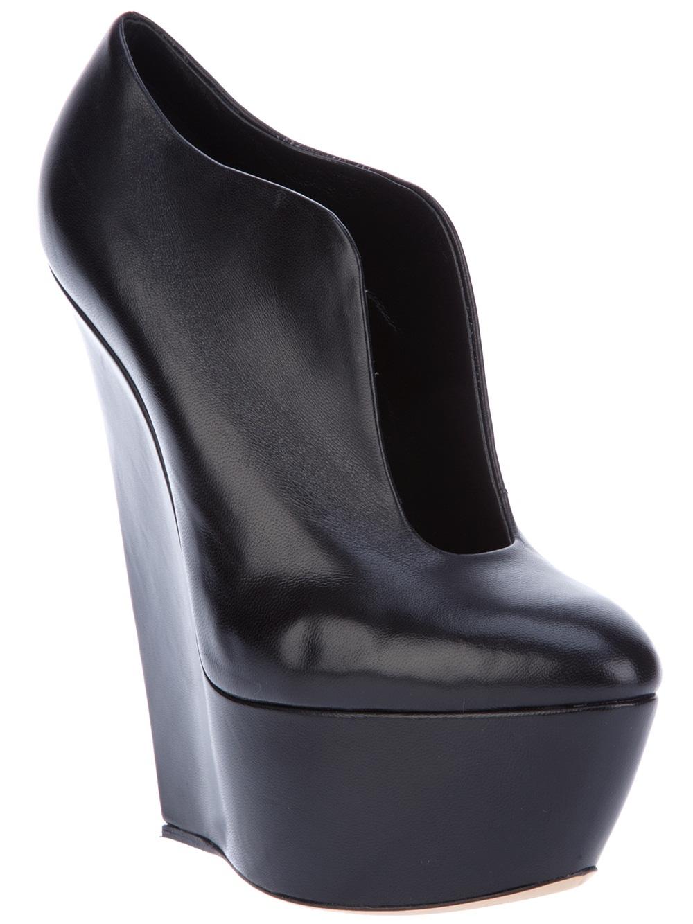 casadei wedge boot in black lyst