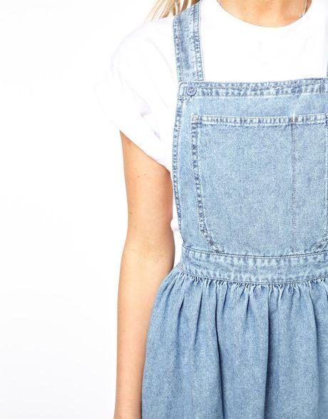 Asos Cross Back Denim Pinafore Dress In Light Vintage Wash