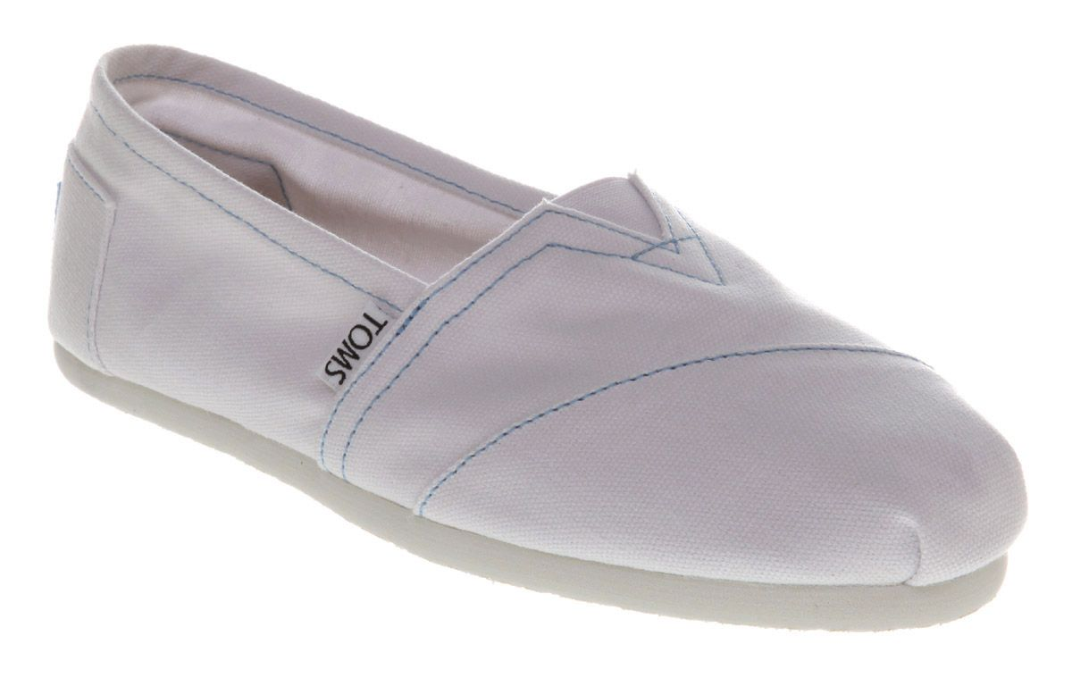 toms classic slip on shoes in white lyst