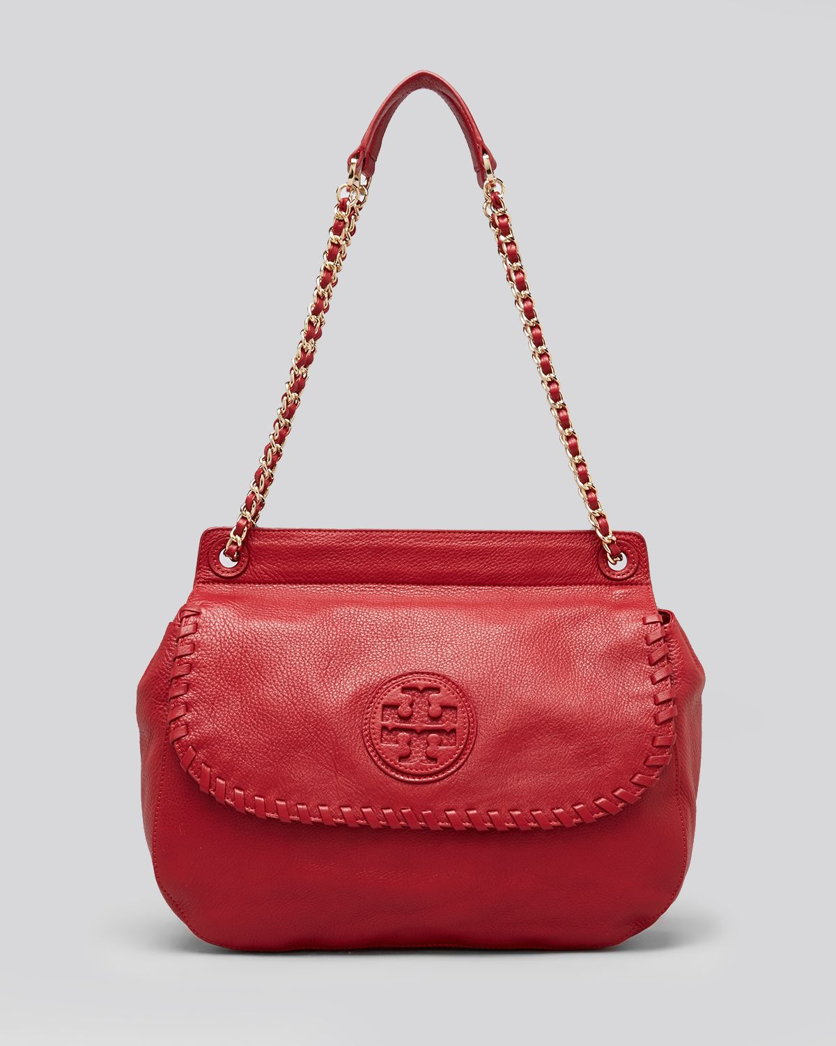 tory burch crossbody marion saddle bag in red rouge red