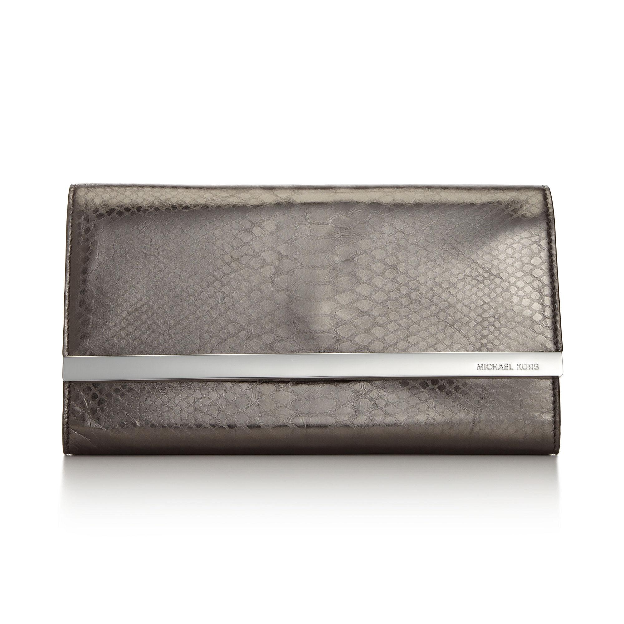 michael kors tilda clutch in silver gunmetal python lyst. Black Bedroom Furniture Sets. Home Design Ideas