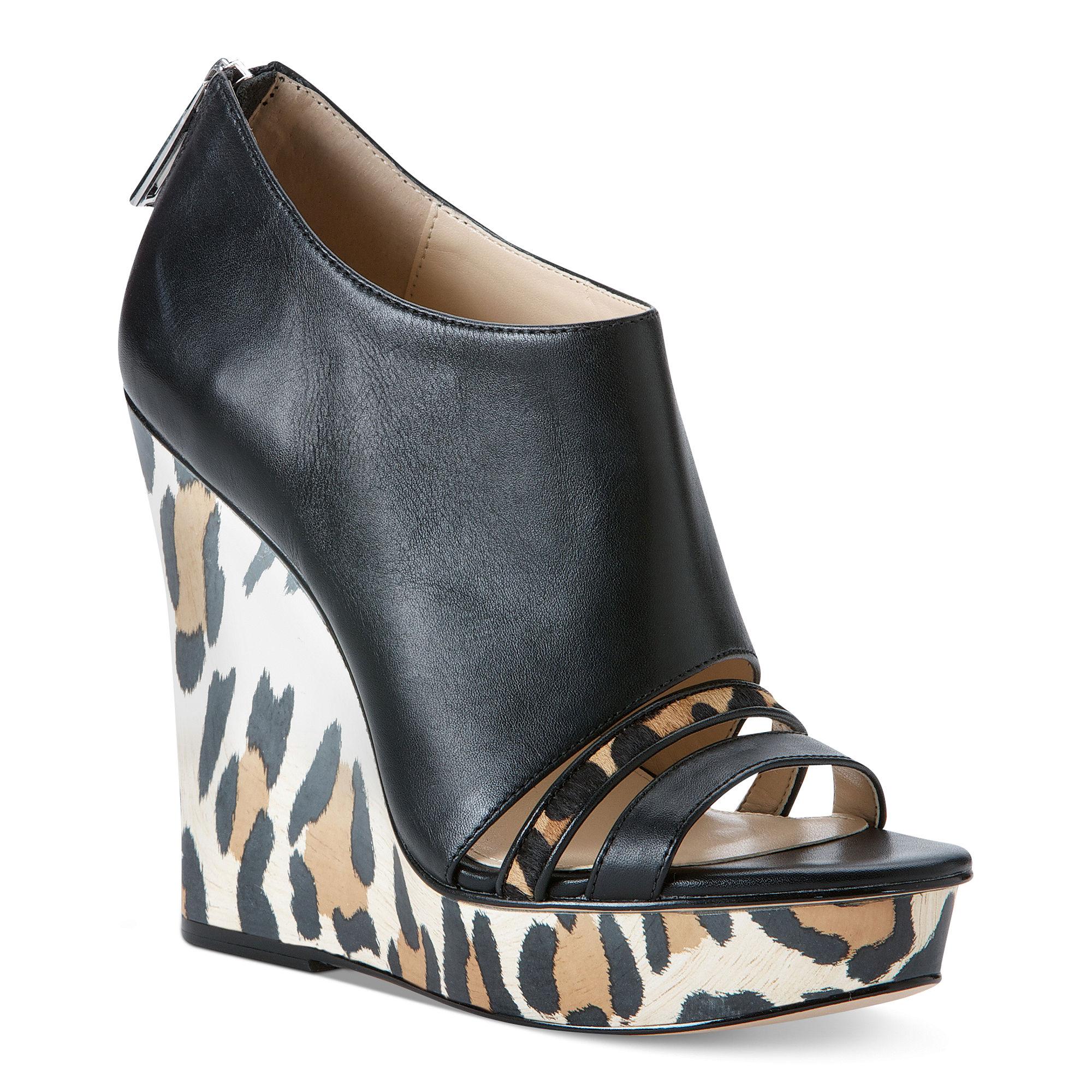 fc7f8c53e3a5 Lyst - Calvin Klein Danette Platform Wedge Sandals in Black
