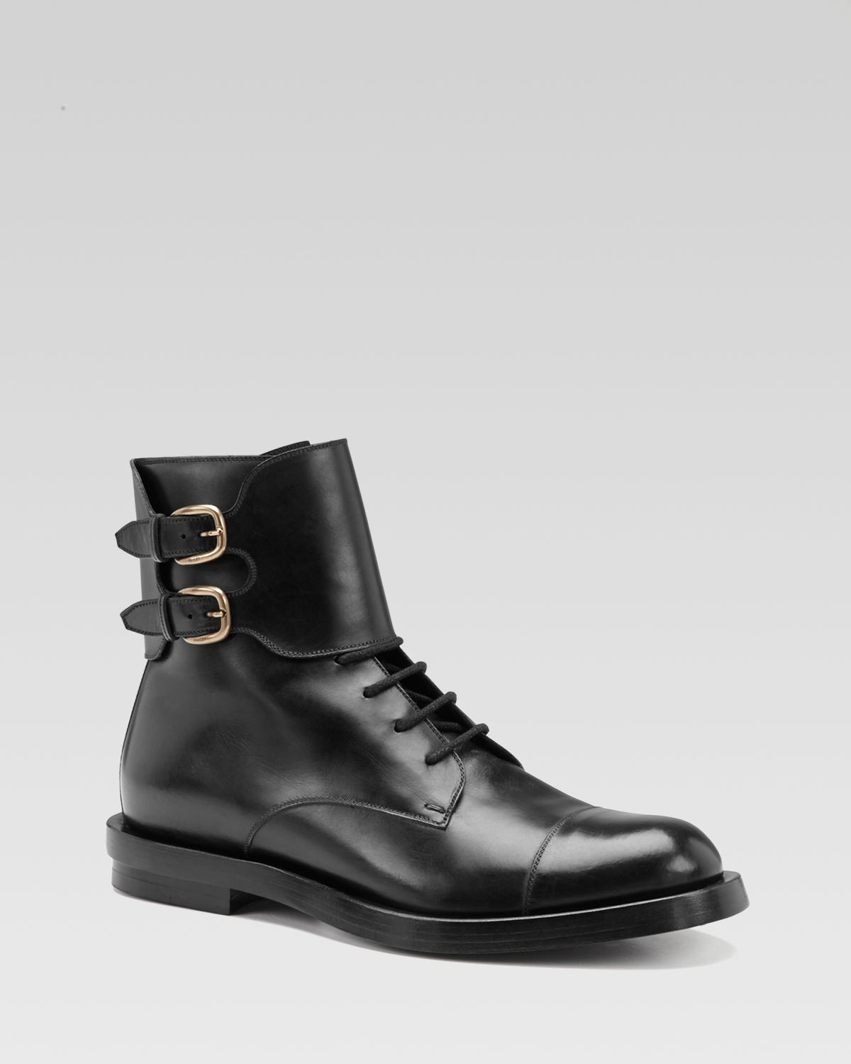 gucci leather buckle boots in black for