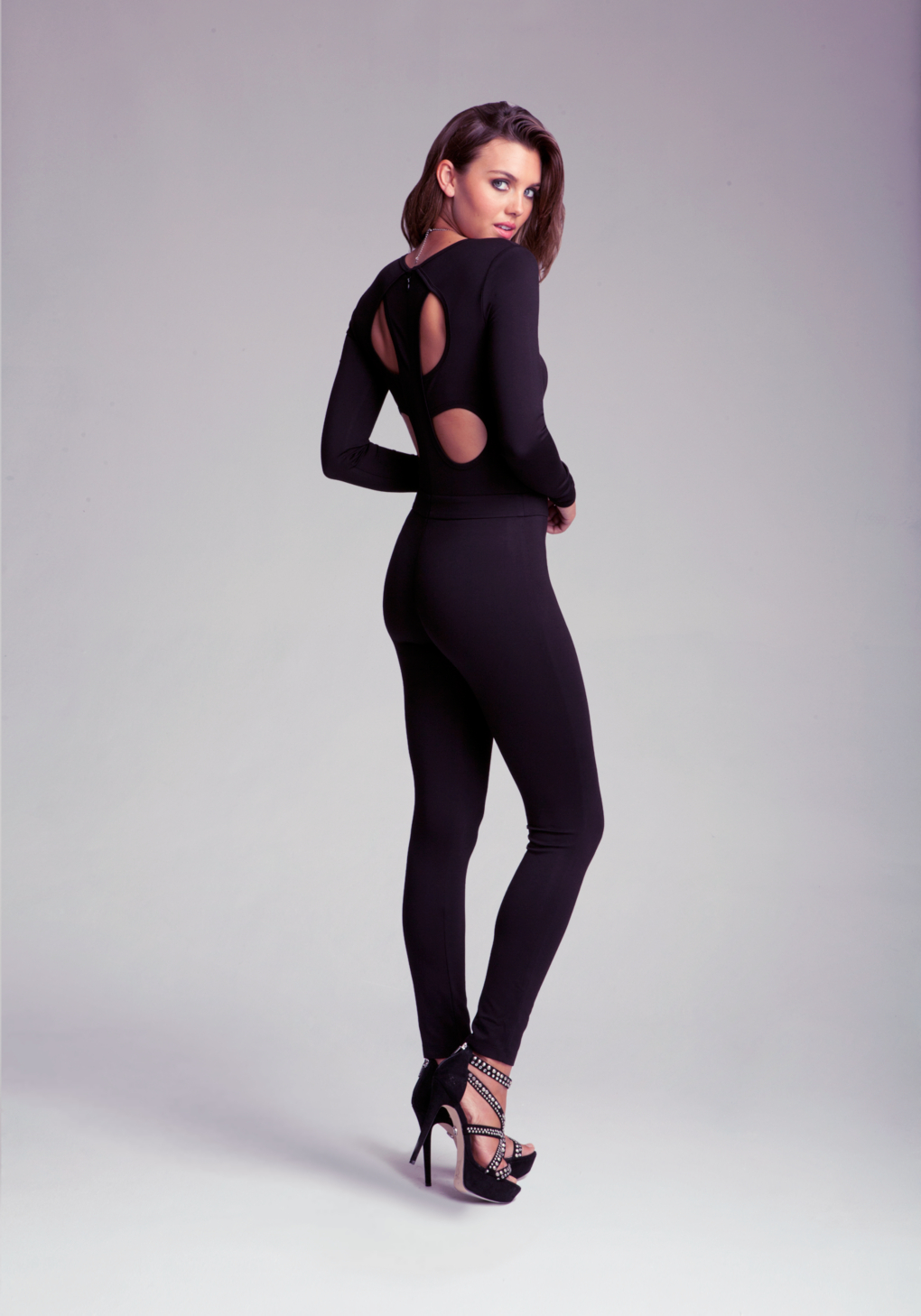 0fe84e94f499 Lyst - Bebe Cloverleaf Cut Out Jumpsuit in Black