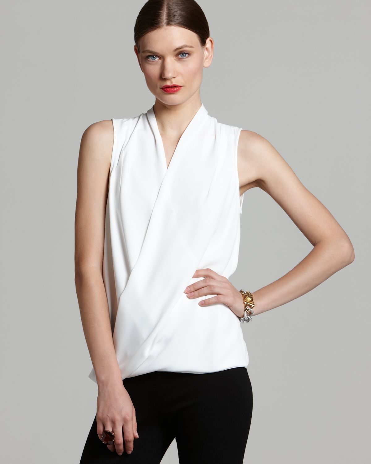 Vince camuto Sleeveless Wrap Top in White | Lyst