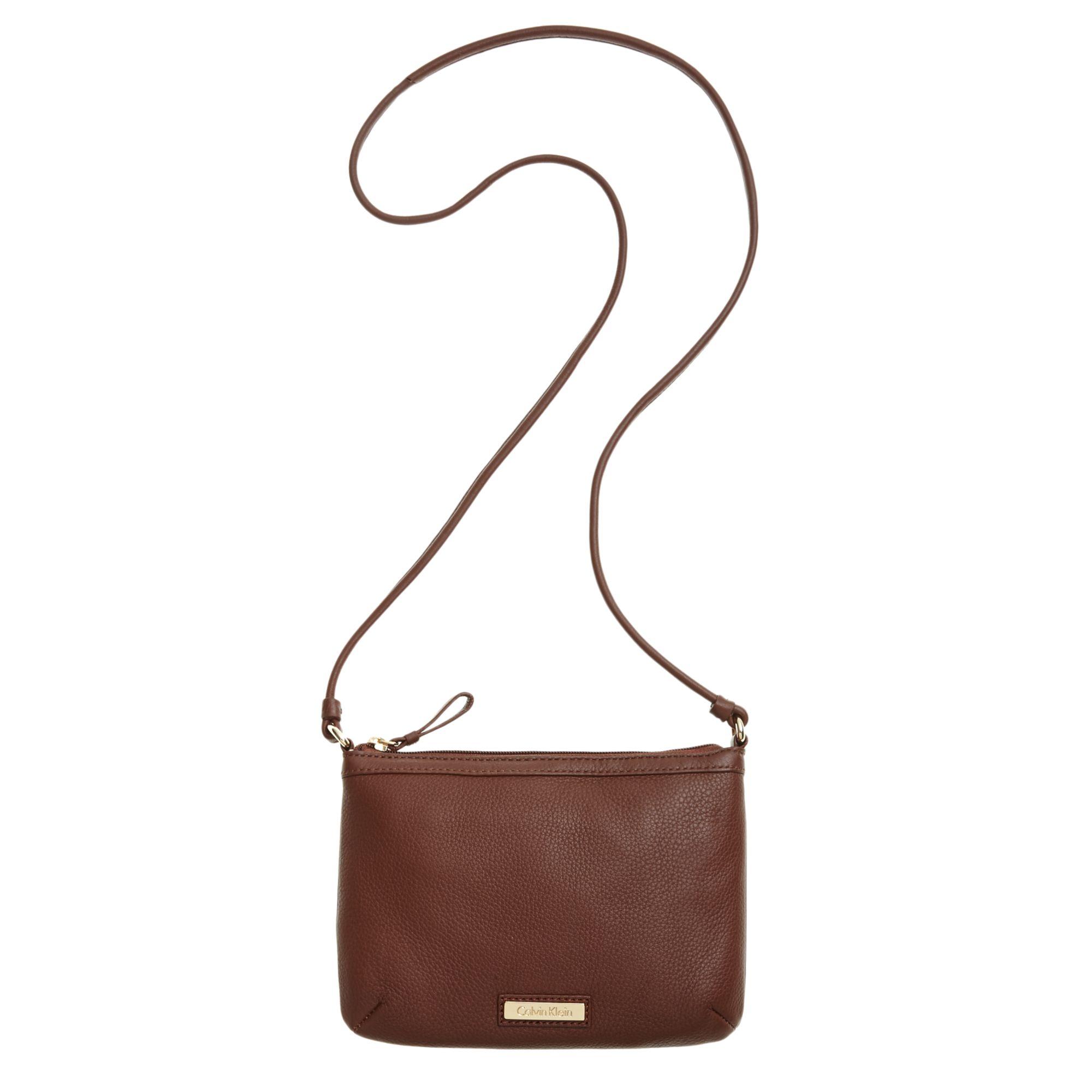 bd4611d0c4ec Lyst - Calvin Klein Key Items Pebble Leather Crossbody in Brown
