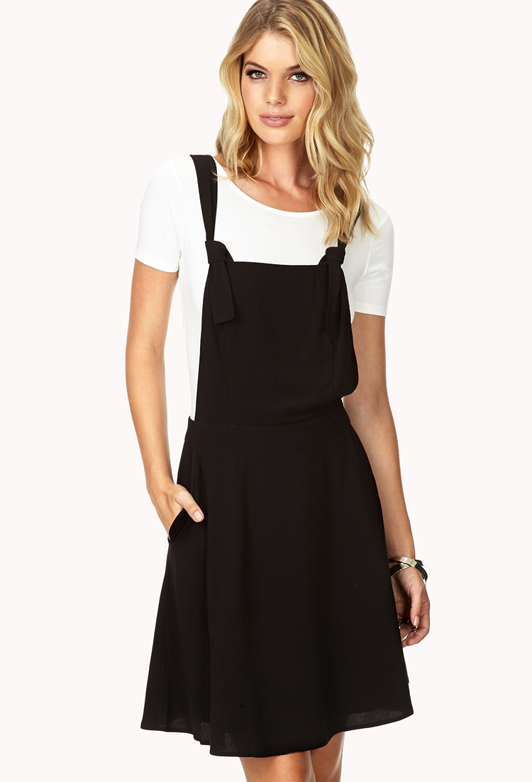 0feb72876a28 Lyst - Forever 21 Contemporary Sleek Skater Overall Dress in Black