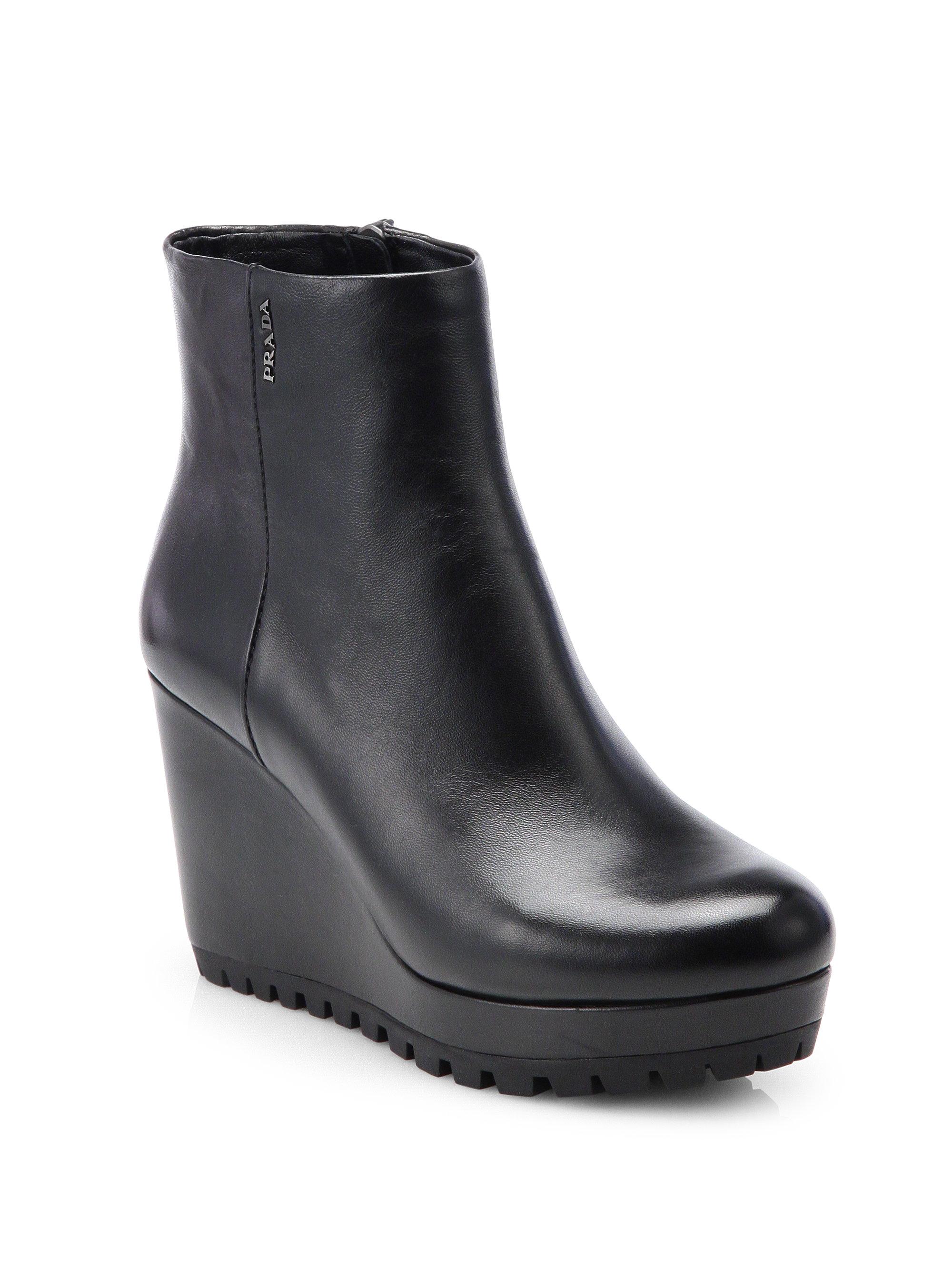 258f134caeda Lyst - Prada Leather Wedge Ankle Boots in Black