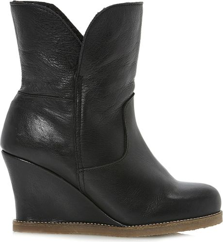 dune faux fur lined leather wedge boots in black black