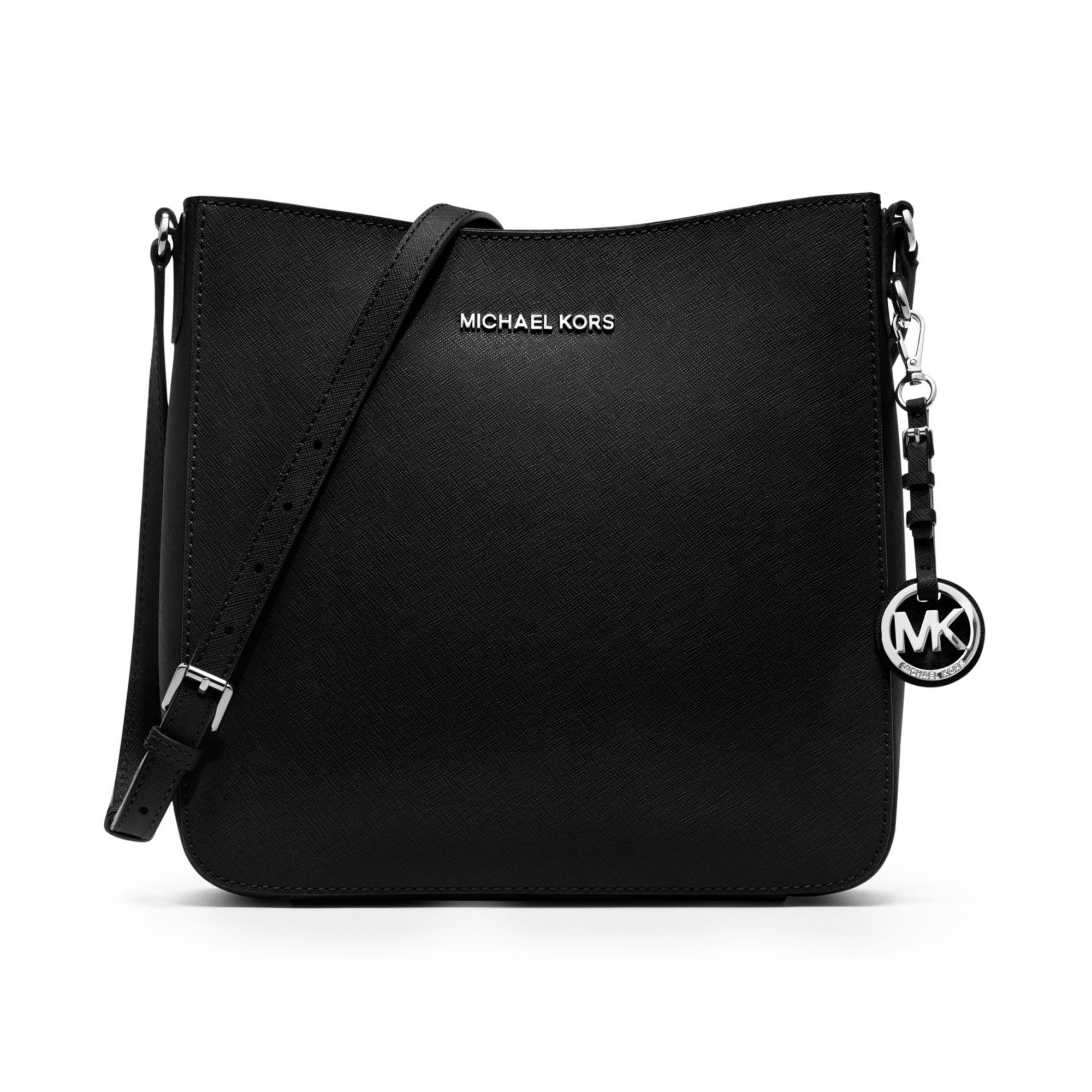 45b448d541d3 Lyst - Michael Kors Jet Set Travel Large Saffiano Messenger Bag in Black