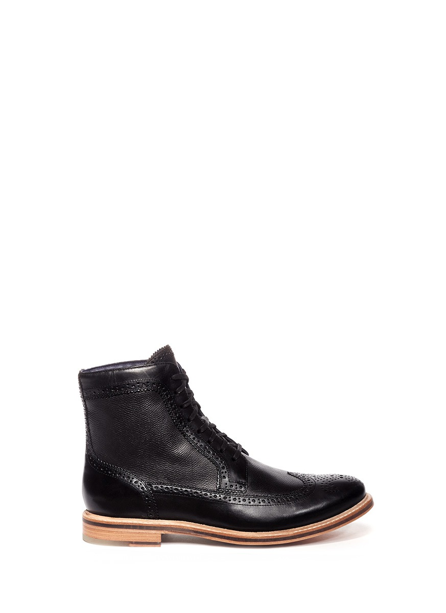 cole haan cooper perforated wingtip boots in black for