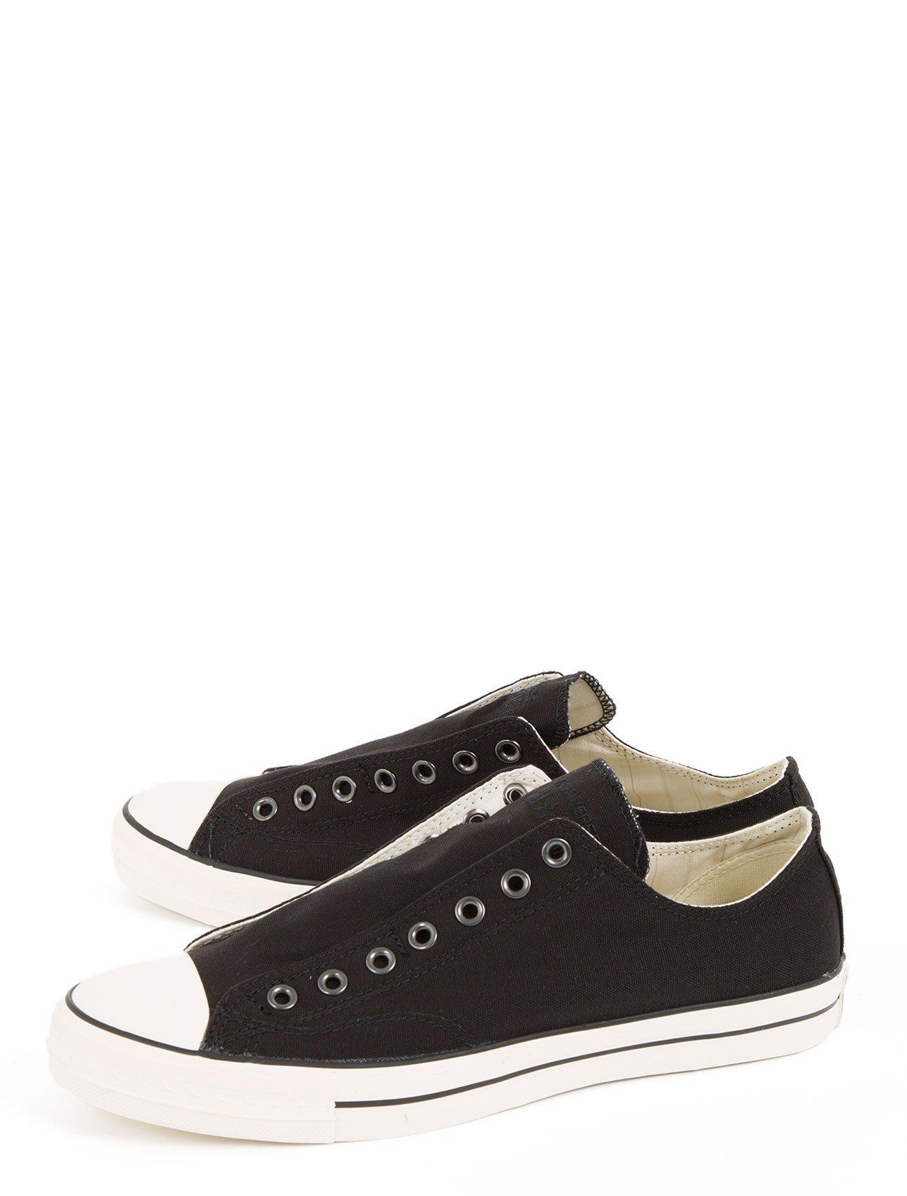 converse slip on sneaker in black for men lyst. Black Bedroom Furniture Sets. Home Design Ideas