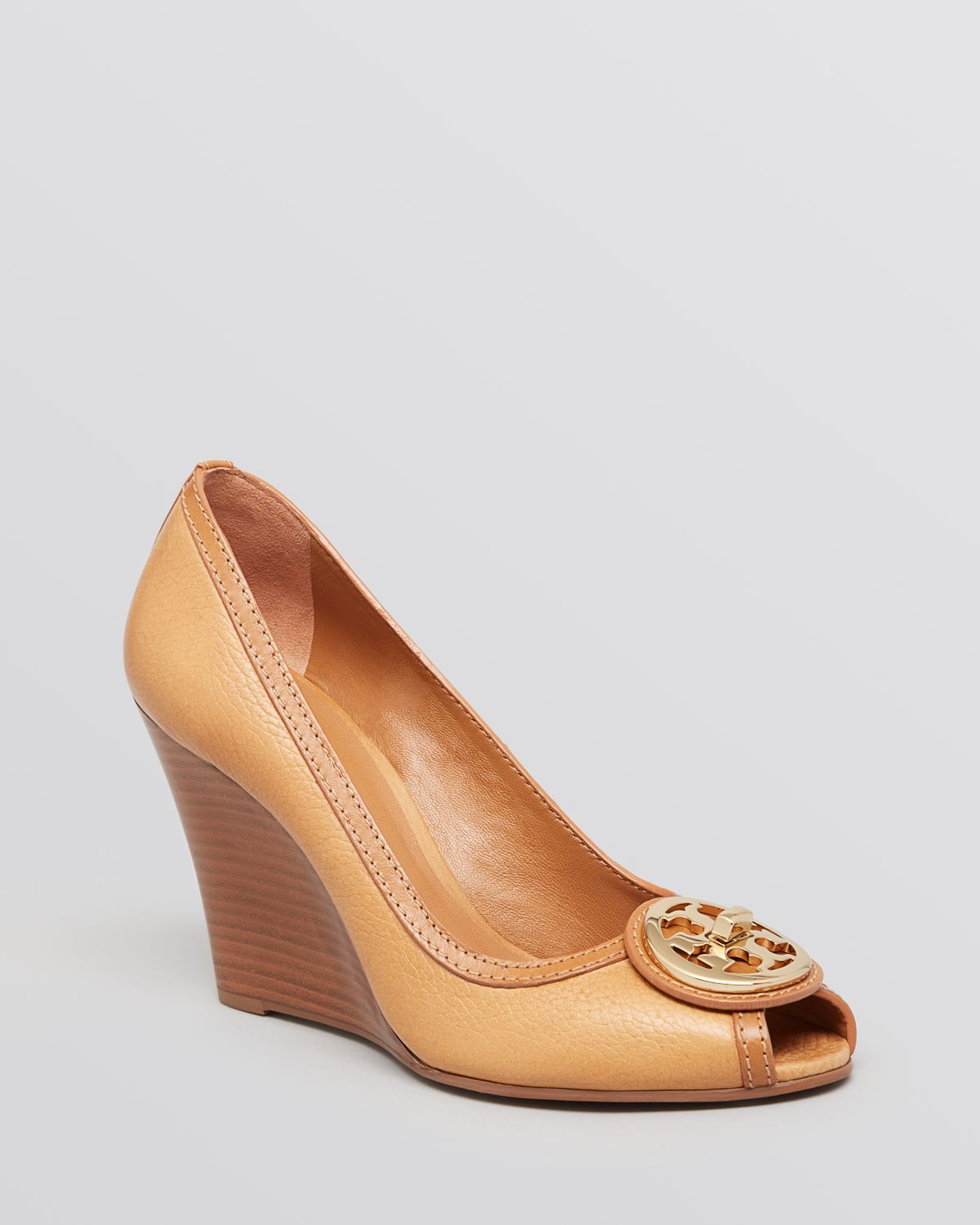 9b5447a0c8d5 Tory Burch Selma Peep Toe Wedge Pumps in Natural - Lyst