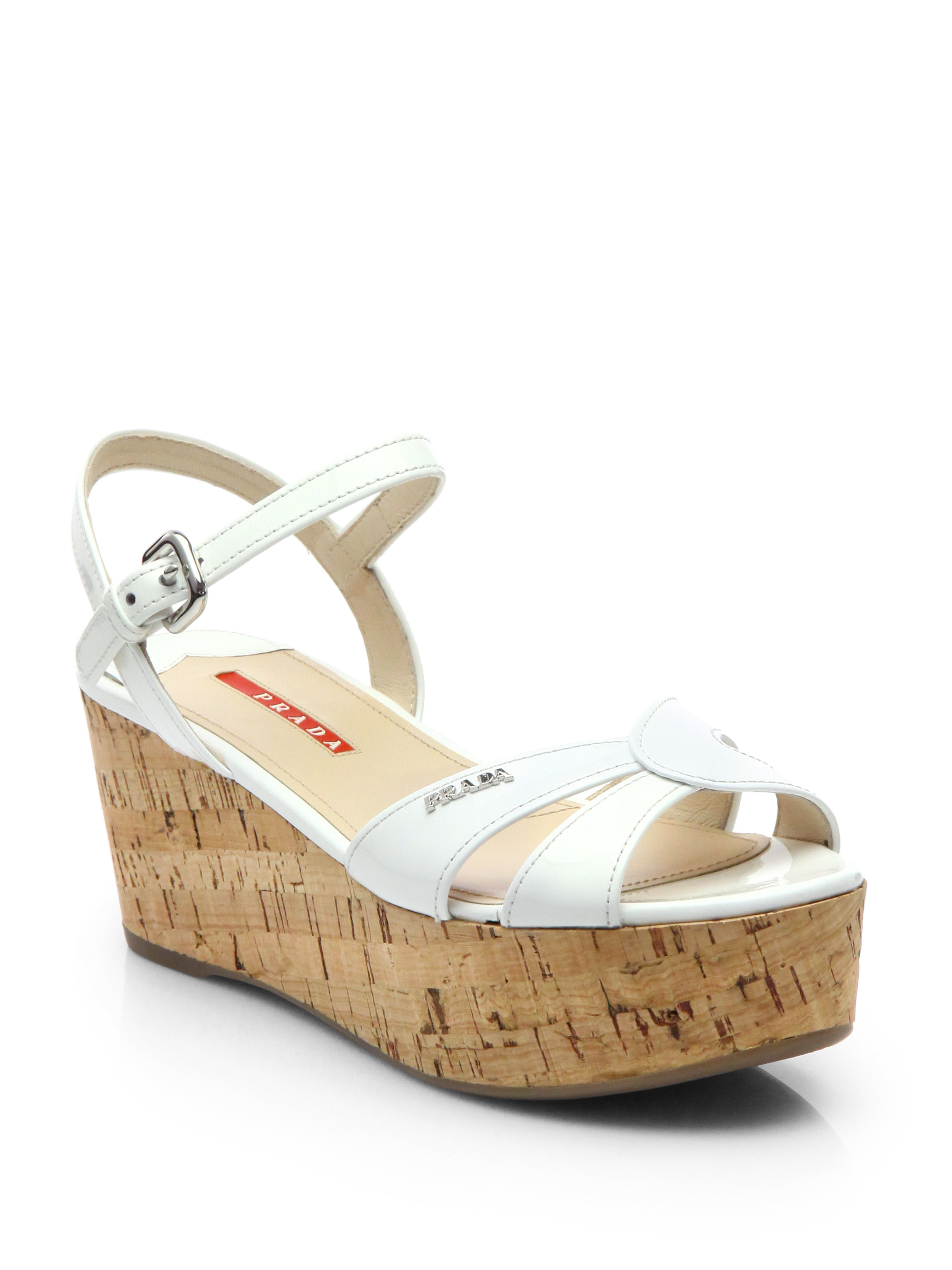 1159fc41cc7 Lyst - Prada Patent Leather Cork Platform Sandals in White