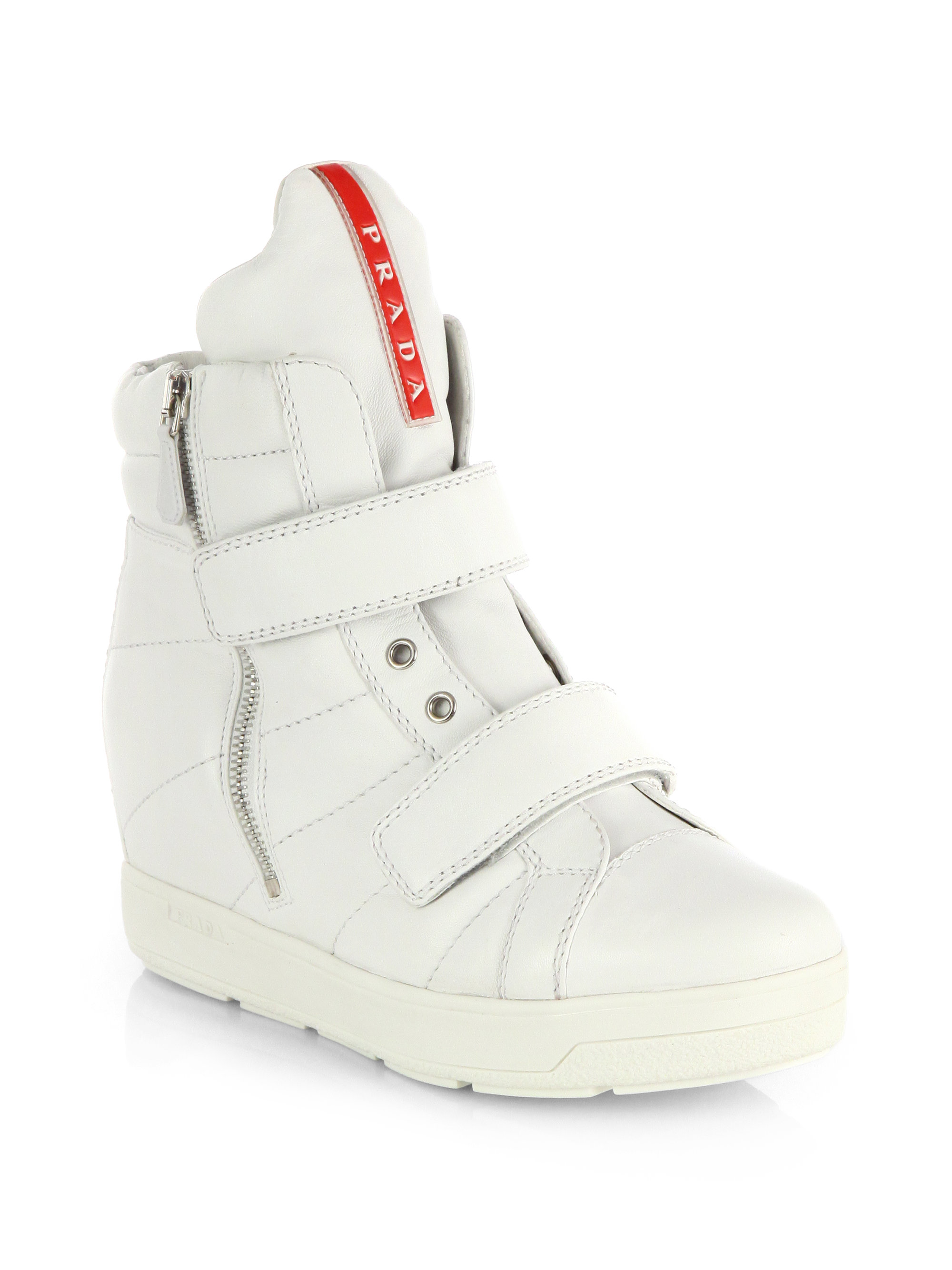 41cb6adc3a2 ... best price lyst prada quilted leather wedge sneakers in white 9058f  8c092