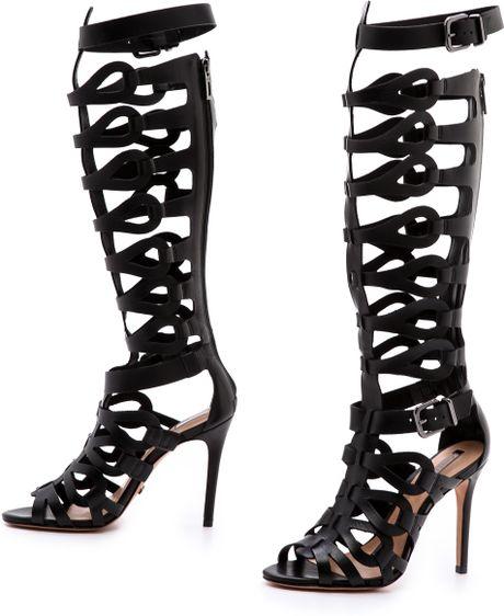 Schutz Eirini Cutout Tall Gladiator Sandals In Black Lyst