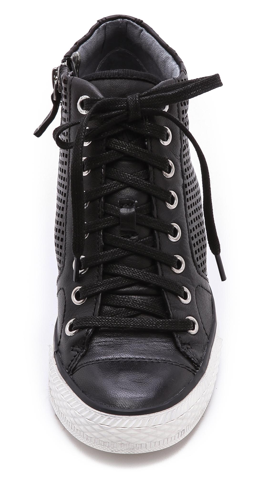6be7e7b679d2 Lyst - DKNY Cindy Perf Wedge Sneakers in Black