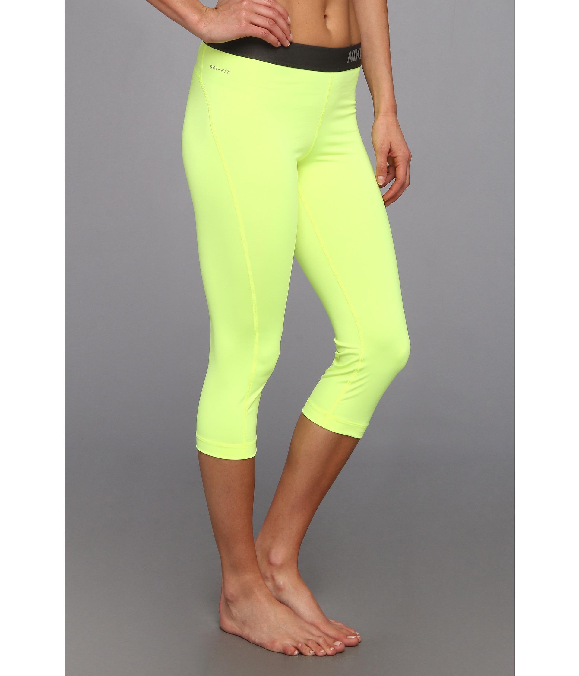 528d6d6160dc6 Nike Pro Capri in Yellow - Lyst