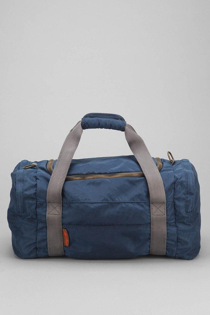 Lyst Jansport Hipster Duffle Bag In Blue For Men