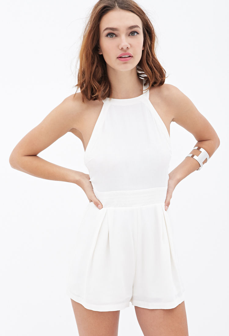 5f37440d943a Lyst - Forever 21 Pleated Crepe Halter Romper in White