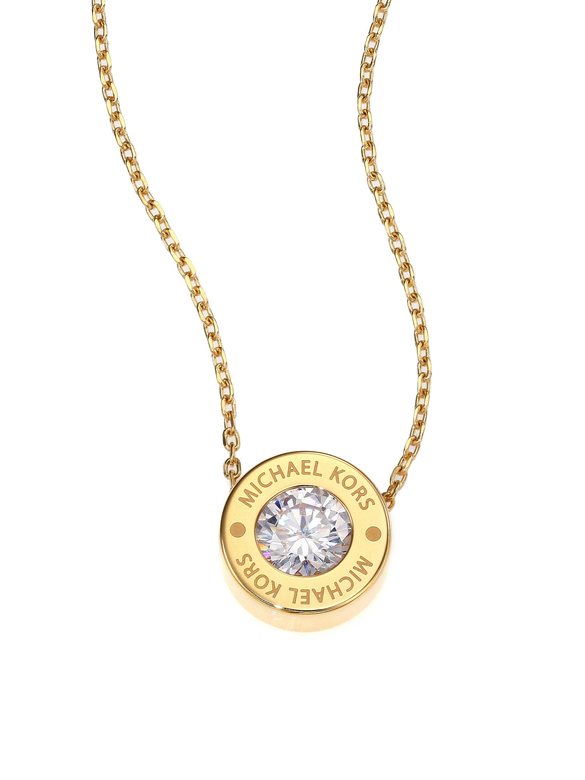 michael kors brilliance logo pendant necklace goldtone in. Black Bedroom Furniture Sets. Home Design Ideas