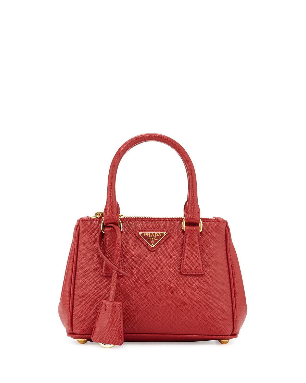 6d2b48f402d Lyst - Prada Extra-Mini Saffiano Leather Cross-Body Bag in Red