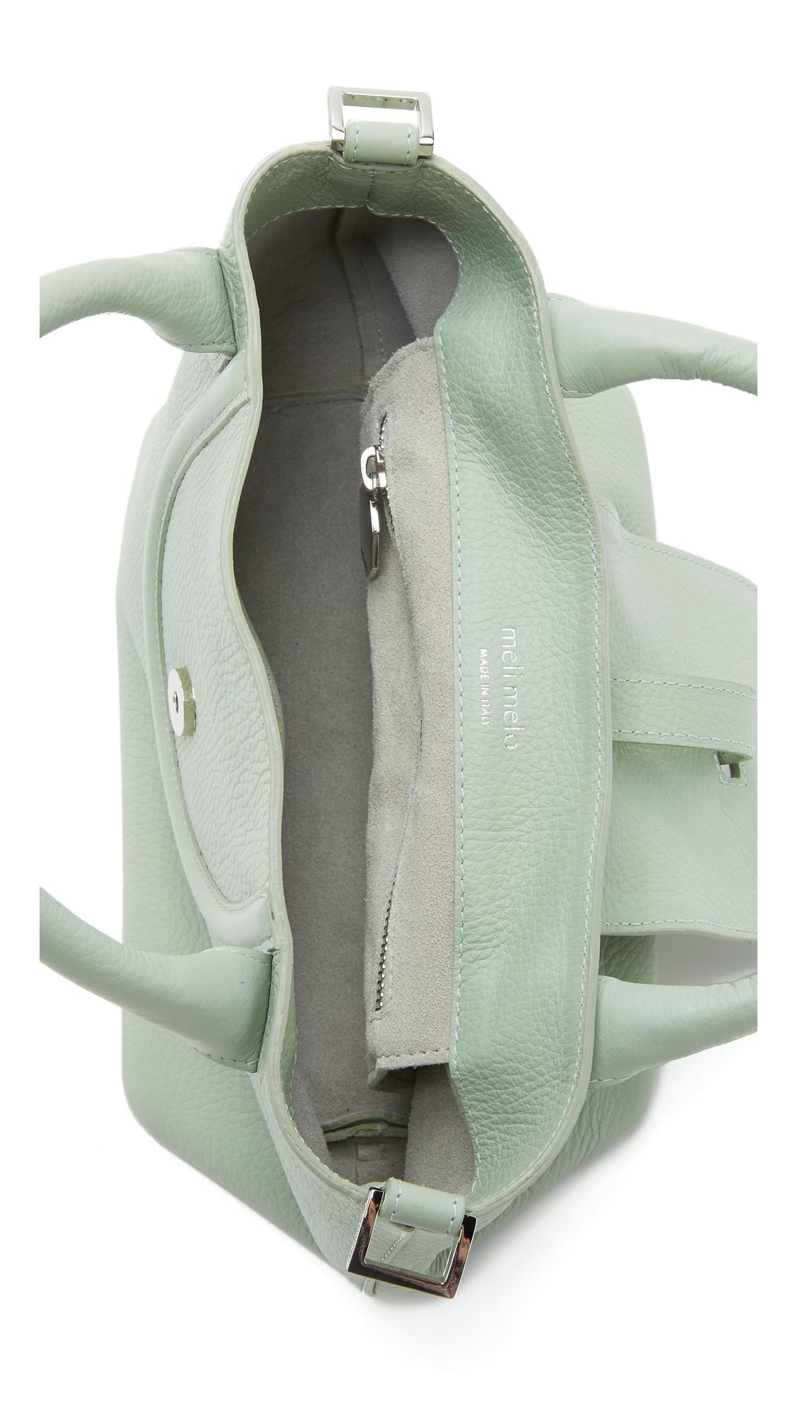 meli melo halo mini cross body bag in green lyst. Black Bedroom Furniture Sets. Home Design Ideas