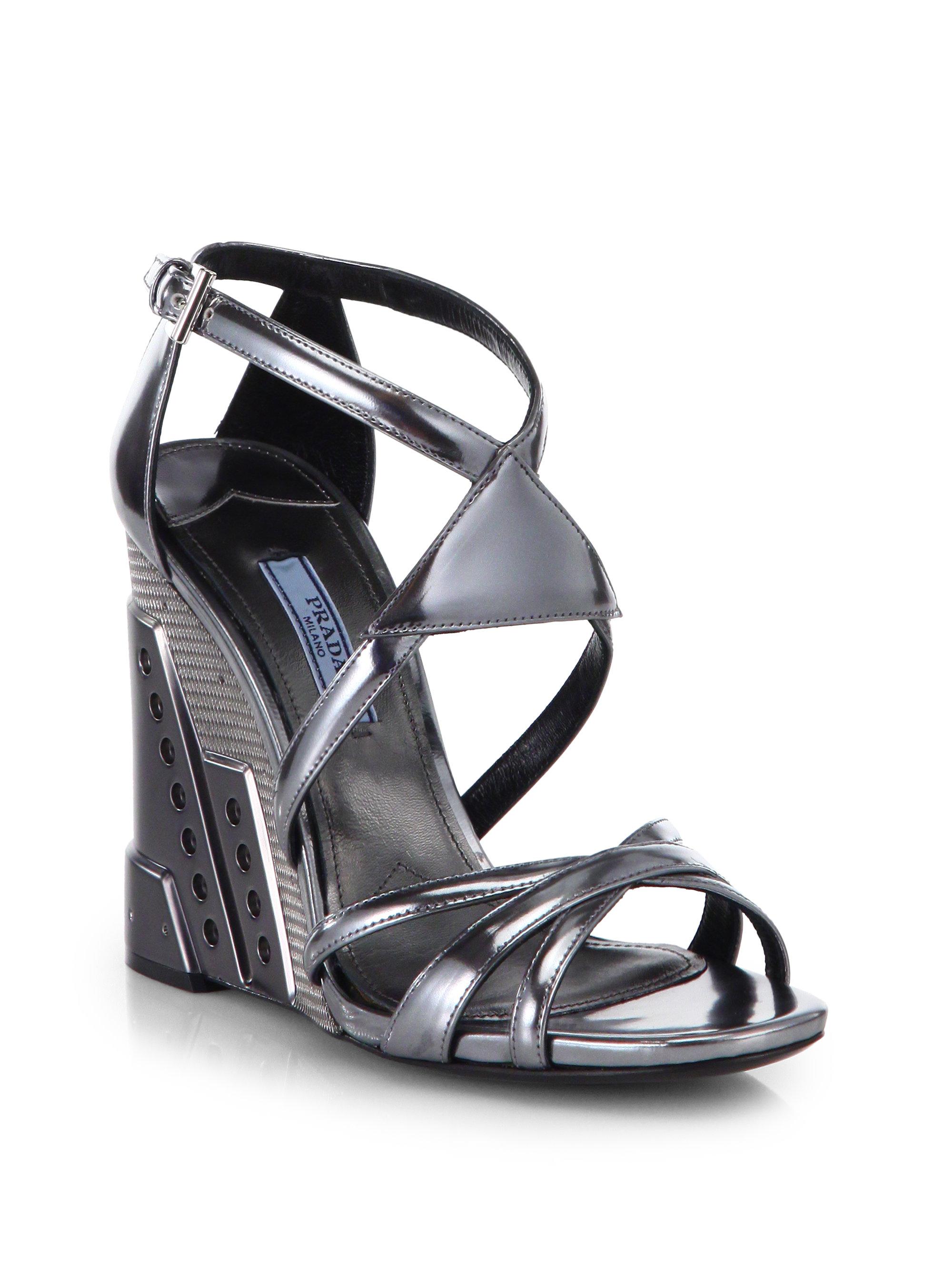 b570c1c14787 Lyst - Prada Metallic Leather Perforated Wedge Sandals in Gray