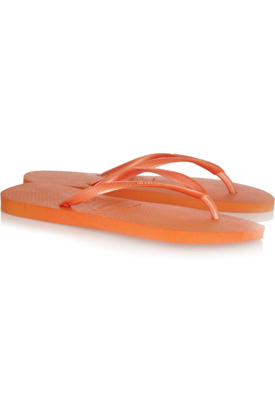 6067bd95585d Havaianas Slim Neon Rubber Flip Flops in Orange - Lyst