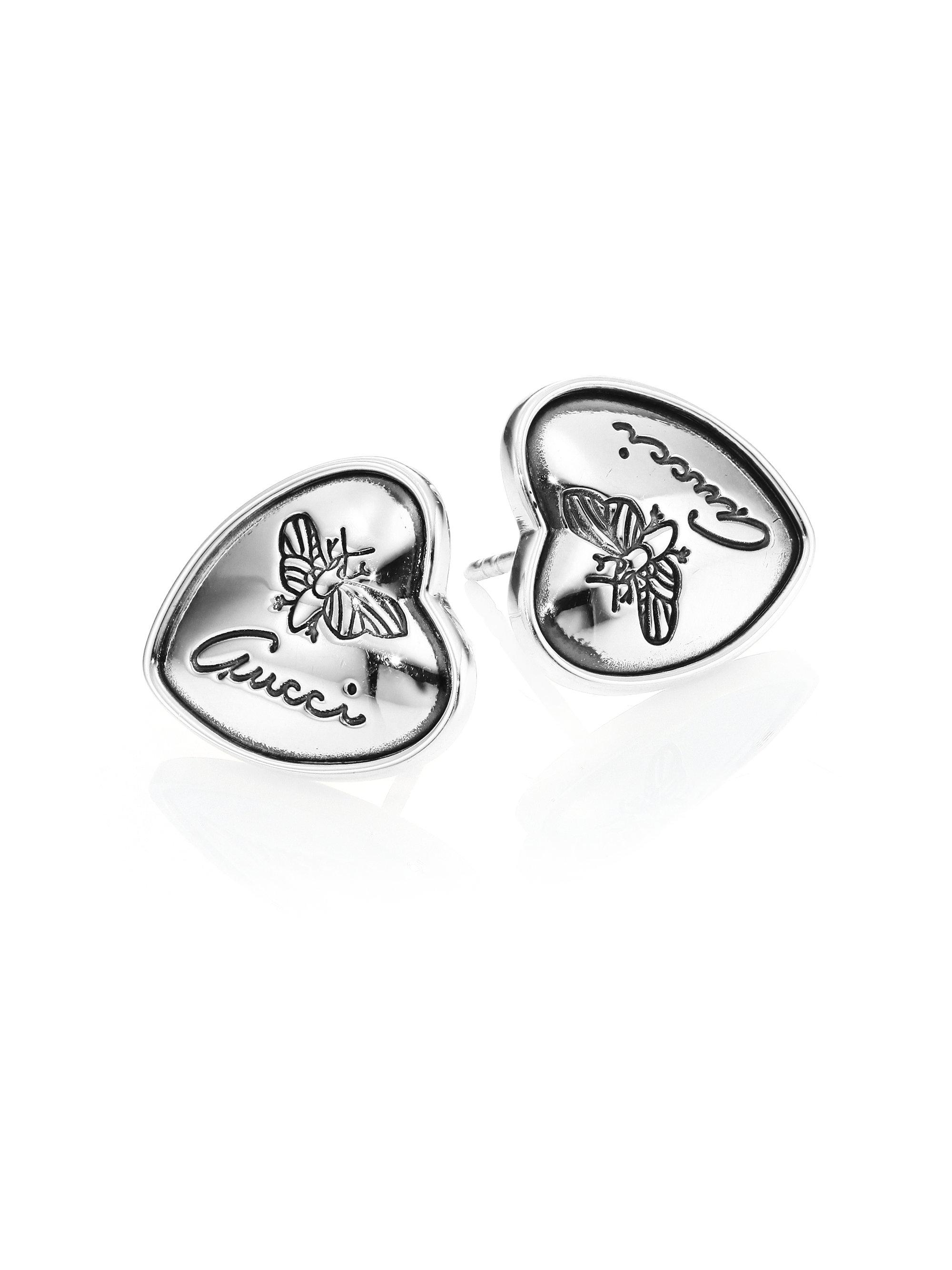 d85ab6e5fd3 Lyst - Gucci Flora Heart Sterling Silver Stud Earrings in Metallic
