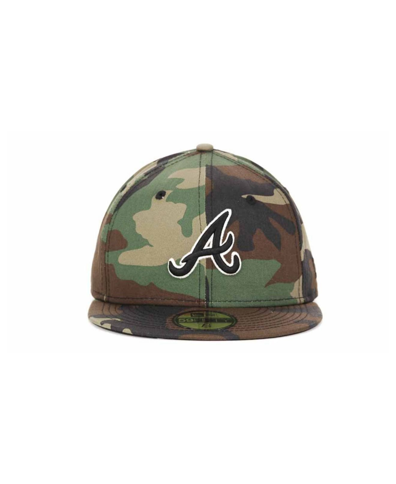 e24feeea130 ... discount code for lyst ktz atlanta braves mlb bc camo 59fifty cap in  green for men