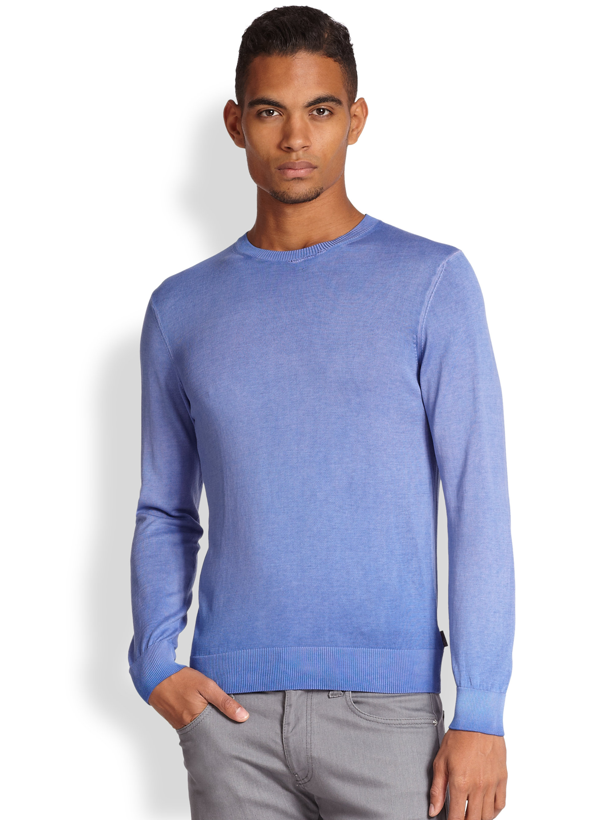 Light Blue Crewneck $79 USD This versatile light blue sweater is tailored to a comfortable slim fit from pure, breathable Merino wool, and features a subtly tapered hem and cuffs, and a crewneck collar.