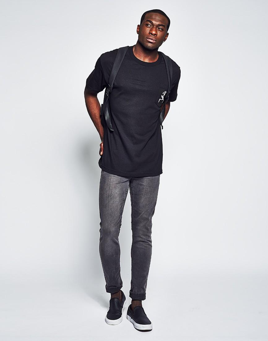 Black t shirt for man - Man In Black T Shirt The Hundreds Skull Bones Pocket T Shirt In Black For