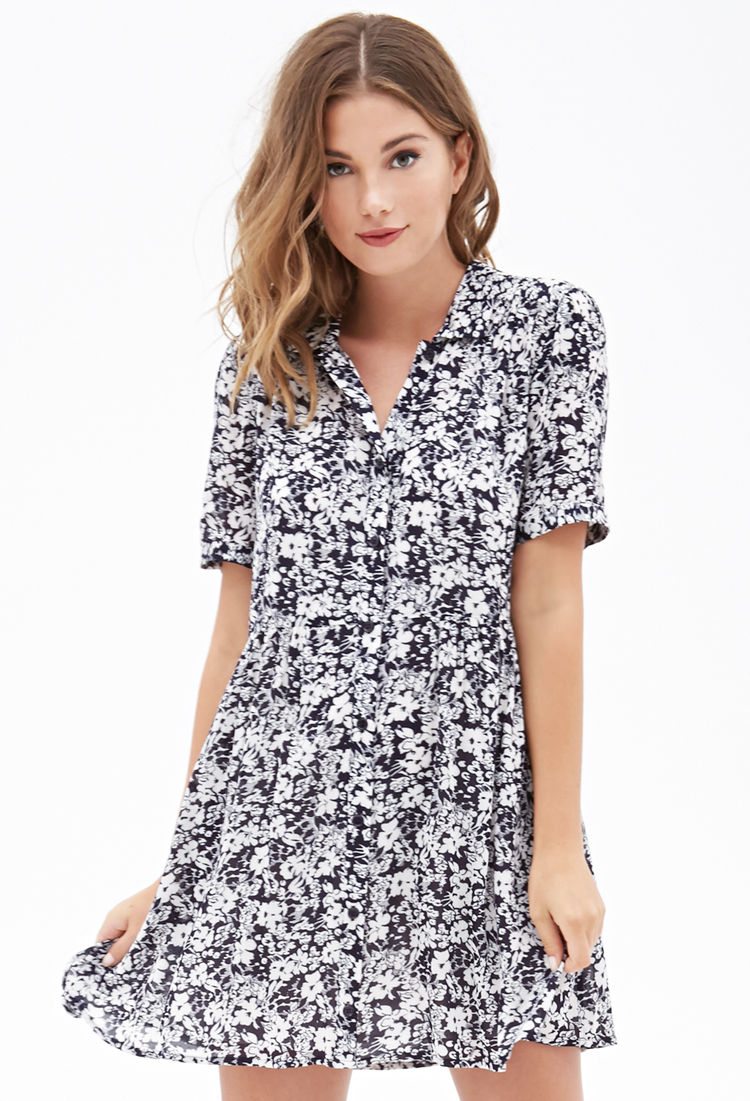 Bursting with flower power, this Button Down Dress will make all your style dreams come true. The easy-to-wear fit and charming allure will have you reaching to .