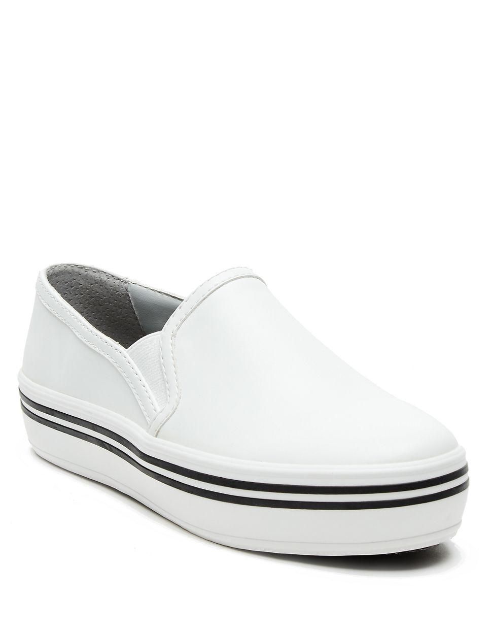 dolce vita jinsy platform slip on sneakers in white lyst