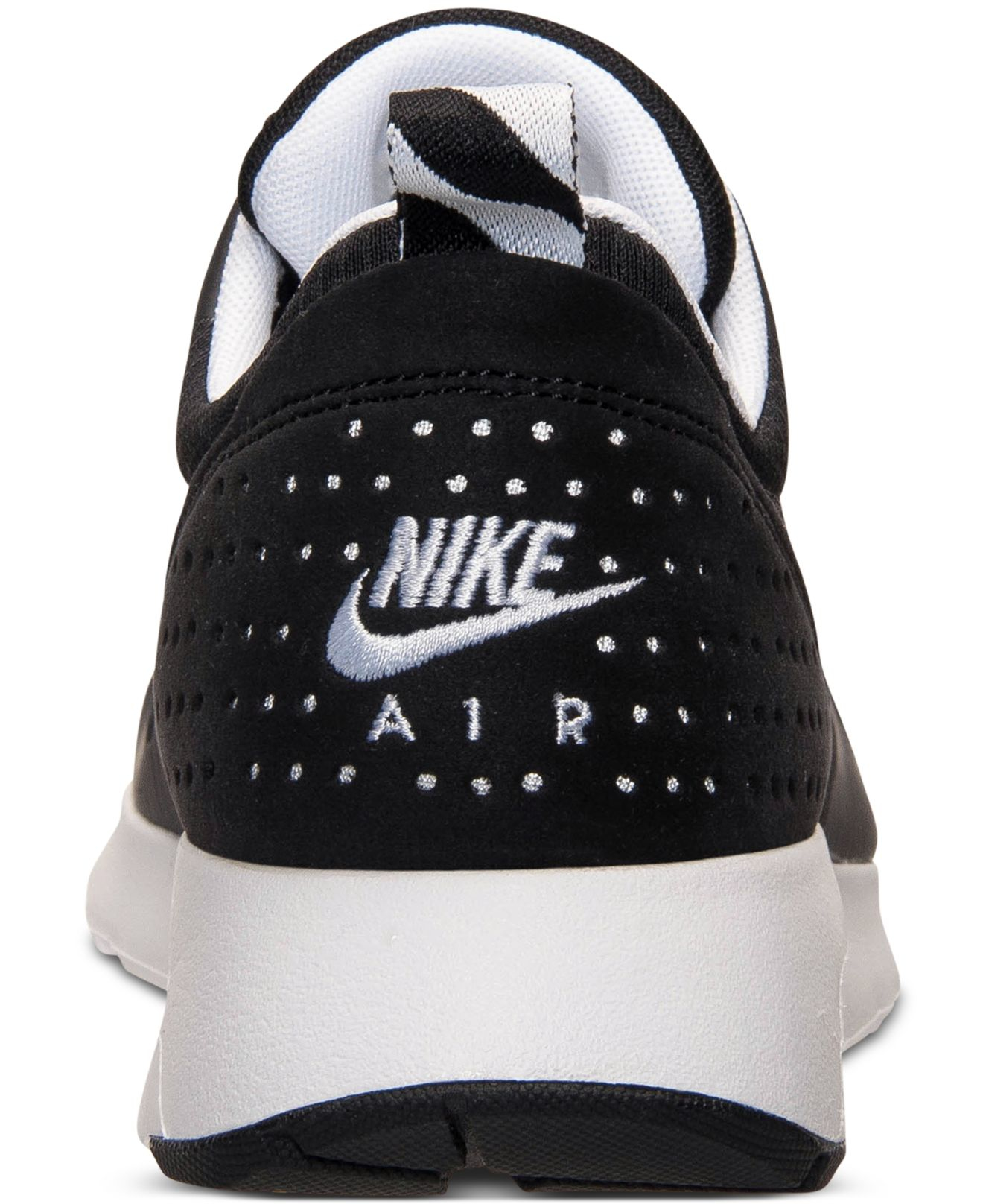 ac5ca144fe7 ... best lyst nike mens air max tavas running sneakers from finish 47ab7  00ec7