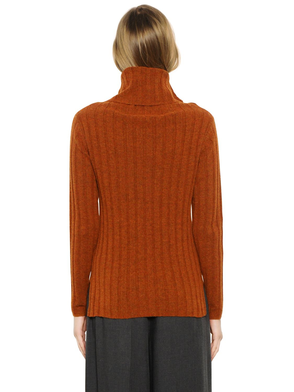 Designers remix Isola Wool Rib Knit Turtleneck Sweater in Orange ...