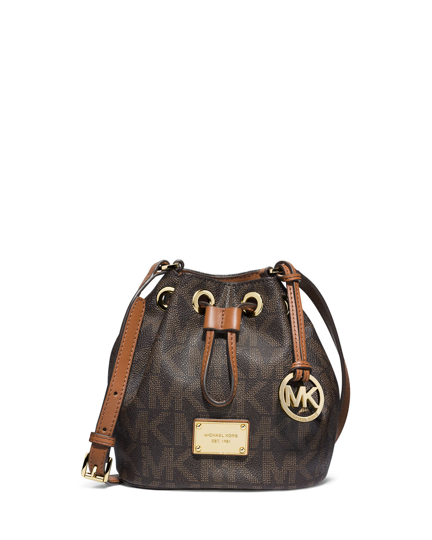 29d11889ac2a ... inexpensive lyst michael michael kors jules logo drawstring crossbody  bag in brown 26823 799ab