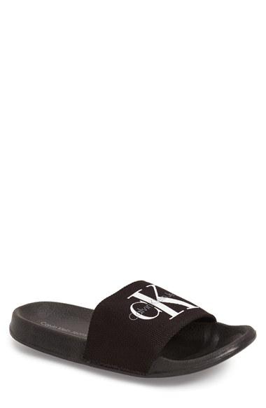 2b36295251cb Lyst - Calvin Klein Viggo Logo-Detail Cavas Slides in Black