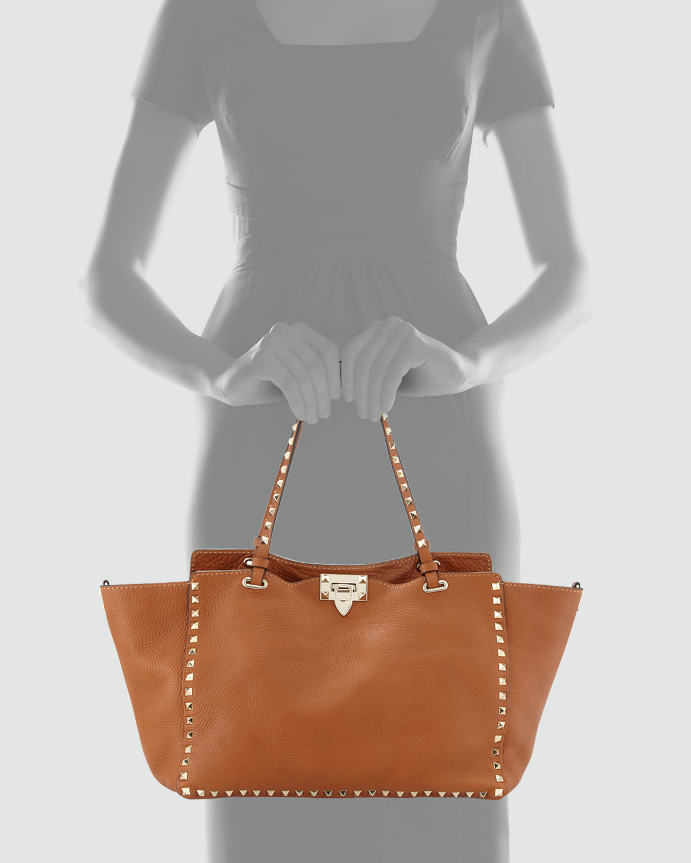 5128bf9edcd Valentino Rockstud Medium Pebbled Tote Bag in Brown - Lyst