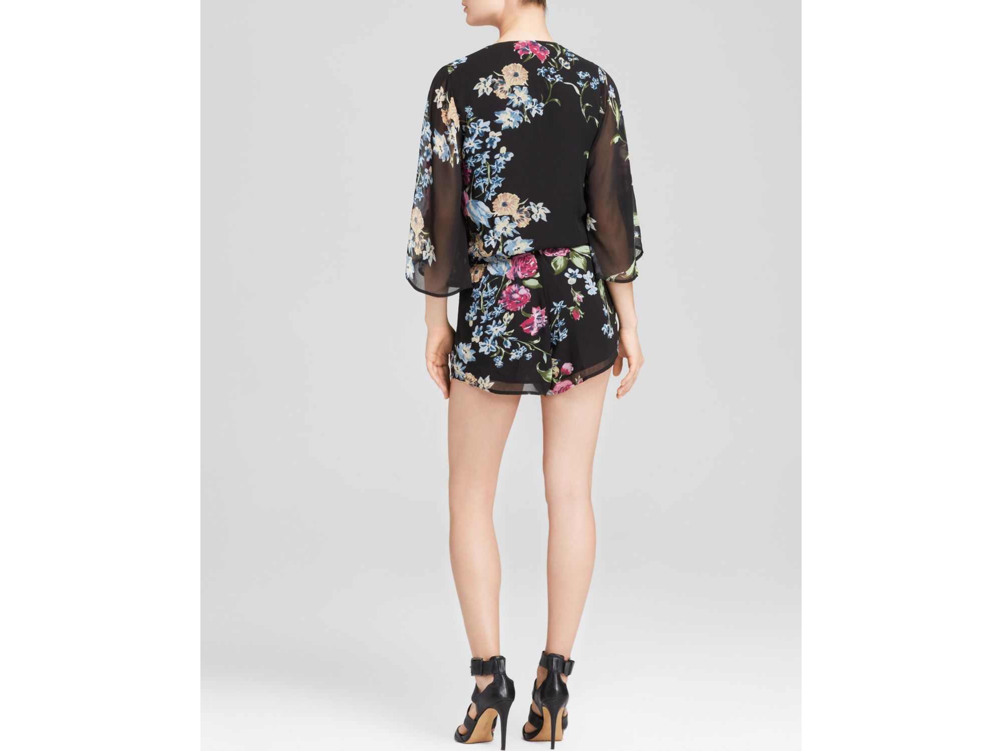 c8d0ab17c1c Lyst - Olivaceous Floral Printed Romper in Black